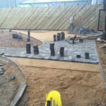 Charcoal Chelsea set paviours being laid for walkway