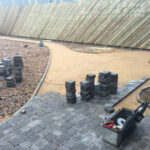 Charcoal Chelsea set paviours being laid