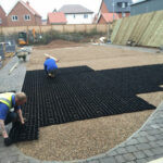 Plastic grids being laid for permeable parking surface
