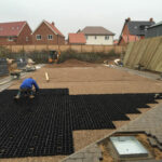 Plastic grids being laid for permeable parking surface 2