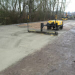 Levelling the concrete with the laser level screed machine
