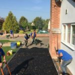 Tar and chipping driveway being hand laid - Halesworth