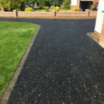 Hot tar and golden pre-coated spec driveway with charcoal edgings - Halesworth