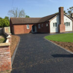 Hot tar and golden pre-coated spec driveway with charcoal edgings 2 - Halesworth