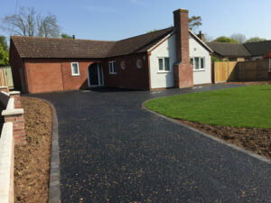 Hot tar and golden pre-coated spec driveway with charcoal edgings 3 - Halesworth