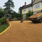 6mm golden pea shingle being laid - Fritton
