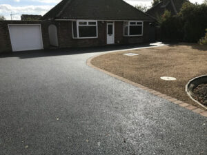 Completed tarmac driveway with red fleck and hot tar & pea shingle - Sprowston, Norfolk