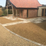 Sun Rise Chelsea set block edgings surrounding 10mm Golden Pea Shingle beds - Old Buckenham