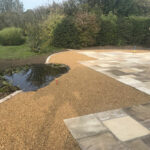 Rejuvenated pond area, surrounded by 10mm Golden Pea Shingle beds - Old Buckenham