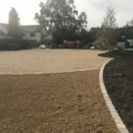 10mm Golden Pea Shingle bed, Golden Sun rise Chelsea sets and 20mm natural stone driveway - Old Buckenham