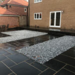 Black Limestone patio area with Ice Blue cobbles - Norwich