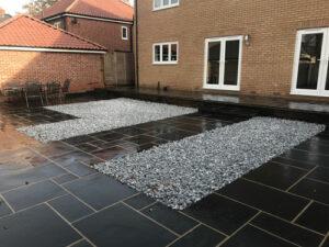 Black Limestone patio area with Ice Blue cobbles - Norwich