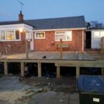 Edge of decking area is being cladded with 125mm grooved decking planks - Chedgrave, Norfolk