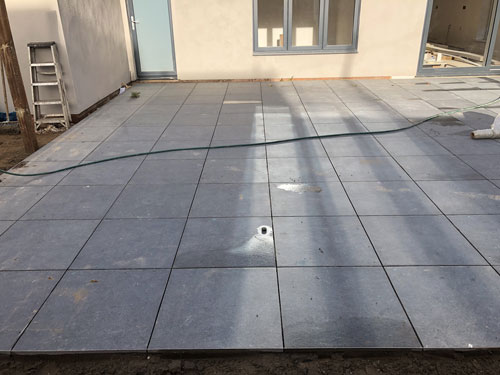 600x600 Grey porcelain patio area waiting to be grouted - Aylsham