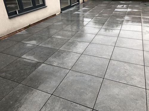 600 x 600 Grey porcelain slab patio area - Aylsham