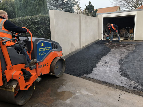 Rolling and raking the stone mastic asphalt - Aylsham