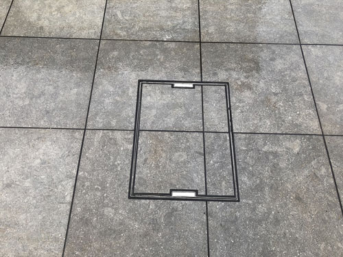 Grey slab manhole cover - Aylsham