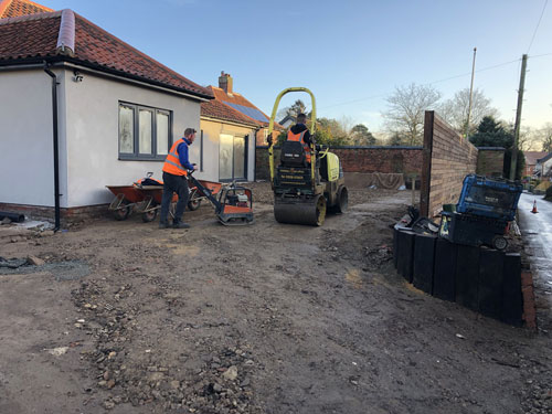 Compacting the crushed hardcore foundation - Aylsham