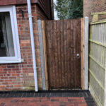 Closeboad pedestrian gate with concrete posts - Swainsthorpe, Norwich