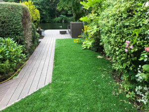 Composite decking laid with fresh lawn turf - Wroxham, Norfolk