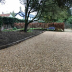 Shingle driveway with sleeper edgings - Norwich, Norfolk