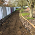 Marking out the pathway shape with wooden gravel boards - Norwich