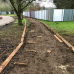 New pathway lined out with wooden gravel boards