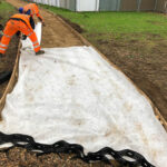 Installing terram matting at base of foundation